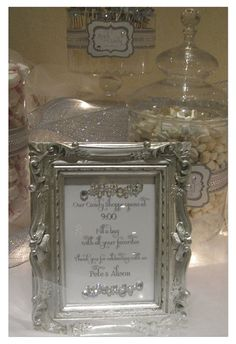 White and Silver Candy Buffet for wedding by The Candy Brigade at www.thecandybrigade.com
