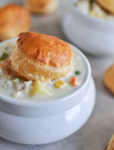 Chicken Pot Pie Soup.  Make the soup and package the puff pastry biscuits separately for the recipient to add when it's ready to eat.