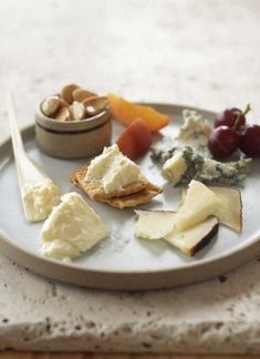 appetizer: cheese plate with dried fruit and almonds #saveur #dinnerparty