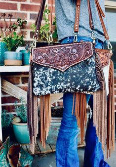 """Imagine: modern-day cowgirl meets retro-leather woman. That is just the work that Katie Dovenberg produces at her one-woman leather shop named """"Teal Ranch Leather"""". Katie's deep love for working Cowhorses and leatherwork come together in all of her one-of-a-kind pieces."""