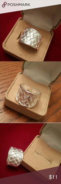NWT STERLING SILVER COCKTAIL RING NWT ladies Sterling silver (#925) cocktail ring. Adjustable to fit most. Beautifully designed and uniquely detailed. Comes in gift box Jewelry
