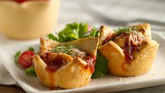 Italian flavored mini pies made easy with frozen chicken bites.