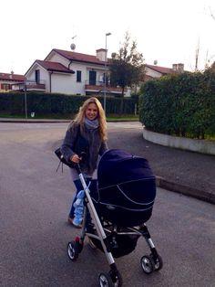 Giorgia Marin walking with her newborn cousin.