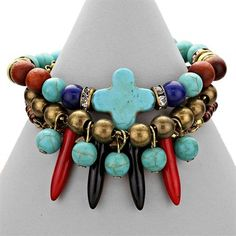 Semi Preciouse Howlite Turquoise Multicolor Layered  Exotic Tribal Boho Chic Bracelet. Get the lowest price on Semi Preciouse Howlite Turquoise Multicolor Layered  Exotic Tribal Boho Chic Bracelet and other fabulous designer clothing and accessories! Shop Tradesy now