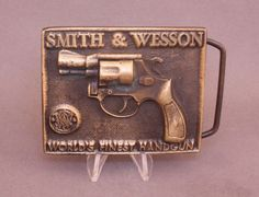 Vintage Smith & Wesson belt buckle available at our eBay store! Vintage Belt Buckles, Smith Wesson, Revolver, Vintage Accessories, Guns, Store, Ebay, Weapons Guns, Larger