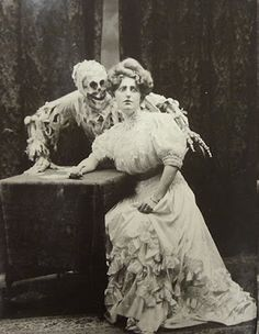 """Death and the Lady"" is the title of an old English folk ballad by J. Deacon between 1683 and 1700, which was published in 1906 by ""City People"", a British newspaper. It was the basis for a vaudeville show Ziegfeld Follies-inspired ""Grand Guignol"", showing card games and alcohol. Photos of Joseph Hall, a photographer from Brooklyn, also famous for his photographs of theater and sports."
