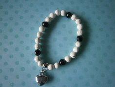 Howlite & Black Puff Heart Bracelet  $14 Rose Jewelry, Jewellery, Savannah Rose, Heart Bracelet, Organza Bags, Black Glass, Pearl Necklace, Beaded Bracelets, Charmed