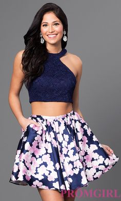 Image of two-piece navy blue homecoming dress with lace top. Front Image