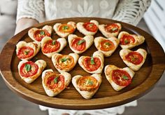 Cheesy tomato tarts- You simply cut out small circles (or hearts) of puff pastry with a cookie cutter. Brush with olive oil, sprinkle on a little white cheddar cheese (shredded), then top with a tomato slice. Bake at 325°F for 20-25 minutes, until the edges begin to brown and look crispy. Top with a little basil leaf (or just chopped basil) just before serving.