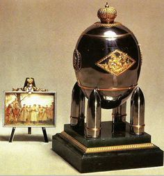 1916 Steel Military Egg (Steel Egg with Miniature Easel)  was a gift from Nicholas II to Alexandra Fyodorovna. The steel egg has gold patterns and is surrounded by a gold crown rests on four artillery shells.The surprise was a Miniature Easel displaying the Emperor Nicholas II and his son at the front. Currently the egg is at the Kremlin Armoury Museum, Moscow.