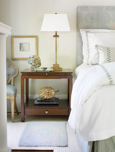 Soft blue for a bedroom, and not too much of it, plus dark wood and subdued gold touches. By Courtney Giles Interiors.