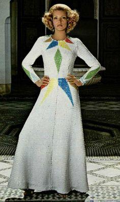 1971's-fashion early 70s long white evening gown bold graphic print at neckline color block green blue red diamond harlequin shapes long sleeves sequins beaded unique unusual