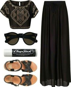 Black embellished crop top, black maxi skirt, black ankle strap sandals.