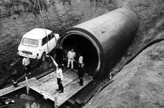 """A Mini is lowered into Coventry sewers at Stoke Aldermoor during the filming of """"THE ITALIAN JOB"""" on September 26, 1968"""
