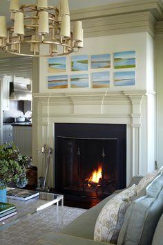 fabulous beach house living room...love the paintings!