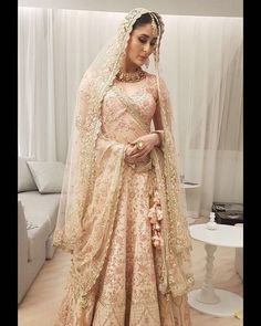 """Jan, 2018: @poonamdamania's Instagram: Kareena Kapoor Khan, Vikram Phadnis set the tone for bridal wear in 2018 with blush pink lehenga. Kareena as a bride in a blush pink lehenga, at the closing of the Shop Qatar Show in Doha. The Veere Di Wedding actor was resplendent in a beautiful blush pink lehenga with intricate golden panel n floral embroidery.  """"#shopqatar2018 thank you @vikramphadnis #qatartourism #kareenakapoor #indianwedding #indianbride via @sunjayjk"""