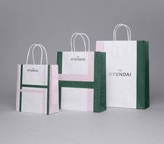 Logotype, packaging and stationery for South Korean department store The Hyundai by graphic design company Studio fnt. Corporate Identity Design, Brand Identity Design, Branding Design, Visual Identity, Shopping Bag Design, Paper Shopping Bag, Bag Packaging, Packaging Design, Paper Bag Design