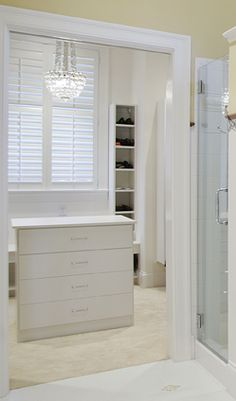 Chandelier in walk-in closet. Home by Martin Bros. Contracting.