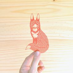 This detailed design is cut with an exacto knife! No laser cutting...just a steady hand! WILD! They also do a screen print pillow plush of their amazing cut out designs!   •tiny fox . 5 x 7 . hand cut papercut by birdmafia on Etsy, $25.00