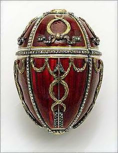 The Rosebud egg is a jeweled enameled Easter egg made by Michael Perchin under the supervision of the Russian jeweler Peter Carl Fabergé5, for Nicholas II of Russia, who presented the egg to his wife, Empress Alexandra Fyodorovna. It was the first egg that Nicholas presented to Alexandra. The egg opens like a bonbonnière to reveal a yellow-enamelled rosebud, in which the two surprises were originally contained, a golden crown, with diamonds & rubies & cabochon ruby pendant.