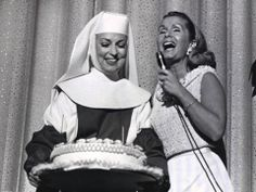 agnes moorehead presenting Debbie Reynolds with a birthday cake during Debbie's live show