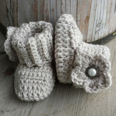 Crochet baby girl boots, in oatmeal with matching flower and pearl button center. size 0 to 3 mo.