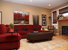 The red couch becomes an instant focal point in the room [Design: Willow Tree Interiors]