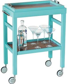 Get the party started with ease using this 2-shelf bar cart with a removable tray. A bright turquoise blue finish lends modern flair to this contemporary 2-shelf bar cart from the Avalon Collection. A stylish burst of color for the living area or dining room, this cart features a removable tray top with a full lower shelf accentuated with a rich zebrawood veneer finish.