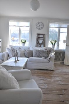 Lovely simple and uncluttered living room. White slipcovers make the difference in this room.