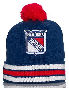 14bc8800b5f MITCHELL AND NESS Hockey knit cap Pom Pom detail on top Fold up brim  Embroidered New York Rangers logo on front MITCHELL AND NESS logo stitching  on back