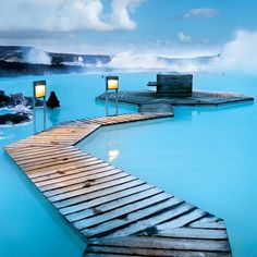 The Blue Lagoon, Iceland - The Blue Lagoon in Reykjavik, Iceland is a naturally heated pool of mineral-rich seawater that's usually anywhere between 98-102 degrees. Visitors can slather themselves in white, silica-based mud and soak while taking in the views of the lava field it's located in. Ummm, yes please!