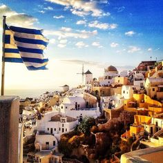 Wonderful colors of the sky and the Greek flag waving , at Santorini island (Σαντορίνη).