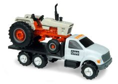 1:64 Dealer Truck With Case 1570 Tractor by ERTL. $9.99. From the Manufacturer                Help the dealership deliver the Case 1570 tractor to the farmer. The Case 1570 tractor is made of die cast construction with soft plastic tires. The dealership flatbed truck can haul almost any row crop tractor or implement.                                    Product Description                Help the dealership deliver the Case 1570 tractor to the farmer. The Case 1570 t...