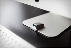 iMacompanion is made out of sand blasted aluminum, and won´t compromise the beautiful, clutter free design of the iMac. It connects to a rear USB port via a paper thin cable under the iMac foot, giving you access to a handy front USB port for day to day uses.