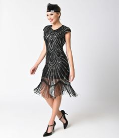 Prohibition ends here, dolls! This gorgeous black flapper is polished royalty with black stretch knit lining and graceful black mesh overlay, cut to form charming cap sleeves and modest scoop neckline. A majestic array of silver and black sequins form daz