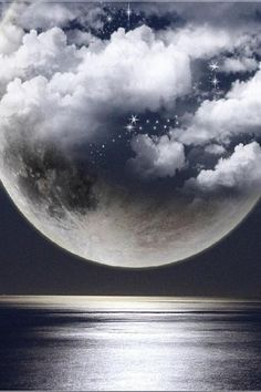 Moon:  A clouded Full Moon.  Awesome Photo!  Go to www.YourTravelVideos.com or just click on photo for home videos and much more on sites like this.