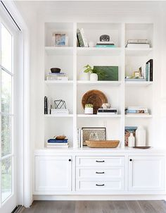 """Inspiration: Soft and Warm Love the shaker style doors; note the middle """"third"""" is larger than the two side panels; think squares.Love the shaker style doors; note the middle """"third"""" is larger than the two side panels; think squares. Bookshelf Styling, Bookshelves Built In, Bookcases, Custom Bookshelves, Bookshelf Ideas, Bookshelf Design, Built In Wall Shelves, Modern Bookshelf, Open Shelves"""