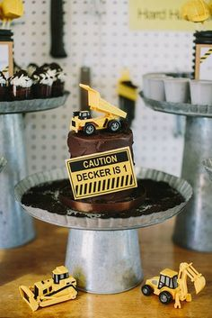 Construction-Themed Cake: No need to go overboard when designing a cake. For this construction-themed party, a simple chocolate cake was elevated with a dump-truck topper and a caution sign.  Source: Inspired by This