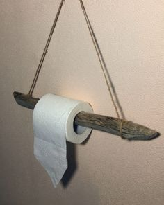 Driftwood Toilet Paper Holder Driftwood Toilet Paper Holder… Driftwood Decor Ideas for the Bathroom, featured on Completely Coastal.