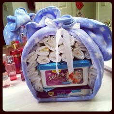 Another gift I made for a boy baby shower. Diapers, blanket, and wipes. Practical Baby Shower Gifts, Baby Shower Gifts For Boys, Baby Shower Parties, Baby Boy Shower, Baby Gifts, Baby Shower Gift Basket, Baby Baskets, Diaper Wreath, Baby Number 2