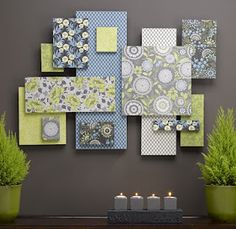 wall art using styrofoam and scrapbook paper. cheap enough to change often!