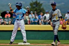 San Lorenzo, Puerto Rico's Yamil Velazques reacts after hitting an RBI-double as Perth, Australia's Chase Diggins walks the infield during the fourth inning of a game in International elimination play at the Little League World Series in South Williamsport, Pa. Saturday. (Matt Slocum/AP)