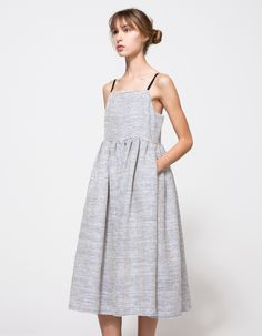 From EDIT, a lighweight strappy dress with flare cut in Navy Raffia. Features straight neckline, darted chest, adjustable black straps, thin straps, high waistline, gathered waist, flare cut, fully lined, zipper back, shin-length and flare fit through the