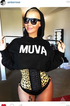 5c0925f724042 Amber Rose looks incredible with the cheetah waist trainer!