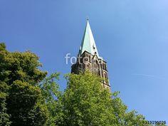 Kirchturmspitze mit Grünspan der Pfarrkirche Herz-Jesu in Münster in Westfalen im Münsterland