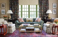 """It's all about symmetry"" Use pattern/prints in pairs so that the same textile is on one side of the room as the other."