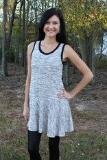 Black and White Drop Waist Dress You can wear this fun dress in so many ways! pair it with a leather jacket, leggings, and boots for a cool look, or dress it up with jewelry, heels,  and a chic blazer for a fabulous night out with the girls. White Barn Boutique