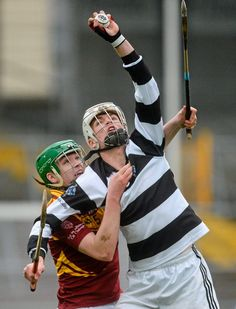 The man in front has used his arm to keep the other player down and away from the ball leaving it clear for himself to catch. Kierans, in action against Des Dunne, Kilkenny CBS. Photo: Piaras Ó Mídheach/Sportsfile Sports Stars, The Man, Derby, Coaching, Champion, Saints, Arm, Action, Sports