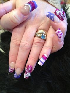 Pink purple and white freehand nail art with white 3D bows over acrylic nails