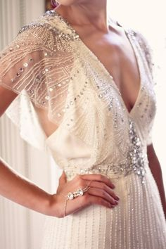 Glamorous jewel embellished wedding dress with intricate patterns; Featured Photographer: Justina Bilodeau Photography